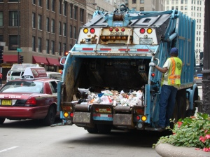A city garbage truck makes collection. Changes are coming to Chicago's waste management system.
