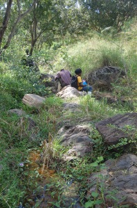 Betty and Sadic work in a seasonal stream (J. Kerbis)