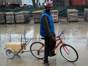 Growing Power Youth Corps intern Henry Dumas at the Iron Street Farm in Bridgeport on a prototype cargo bike designed by Archeworks' Mobile Food Collective (photo: Growing Power)