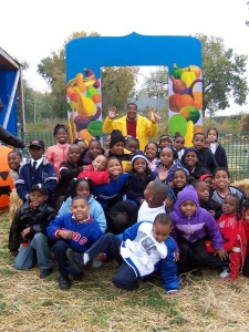 Eden Place Nature Center co-founder Michael Howard (back row, center) with children, Chicago IL