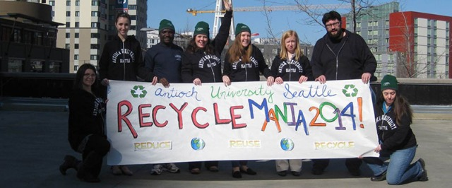 Antioch University students with REcycleMania banne_web banner