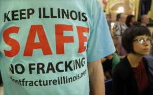 In this May 21, 2013 AP file photo, a protester attends a rally after a House committee hearing on fracking legislation at the state Capitol in Springfield, Ill. CREDIT: AP PHOTO/SETH PERLMAN