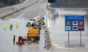Workers from the Missouri department of transportation attempt to pump water off I-55 near Arnold, Missouri on Thursday. (Photograph: The Guardian/Sid Hastings/EPA)