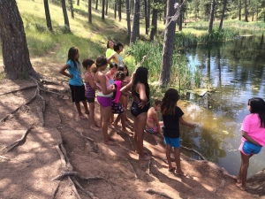 "Campers getting ready to swim at one of the ponds at Crazy Head Springs at the annual weeklong No""Meth""ing Around summer camp in July, 2015, (B. Powers)"