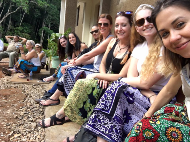 Most of our group, but not all, at the church after planting trees; wearing our kongas (photo: M. Holstein)